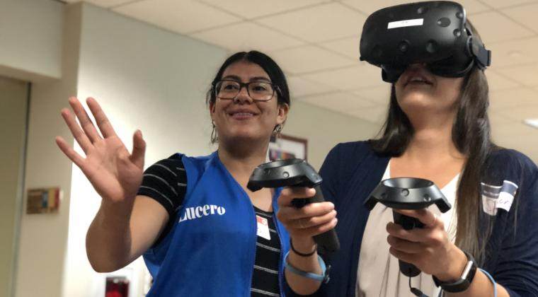Lucero Alvarez Vieyra helping a woman use VR.